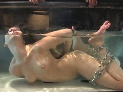 Hot sexy girl is tied, gagged, suspended while suffering through water tortures