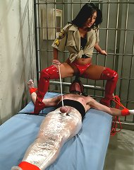 Mistress visits her new prisoner with a few of her toys