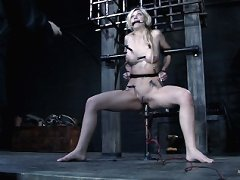 Blonde in hard metal bondage