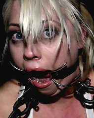 Blonde slave in chain bondage